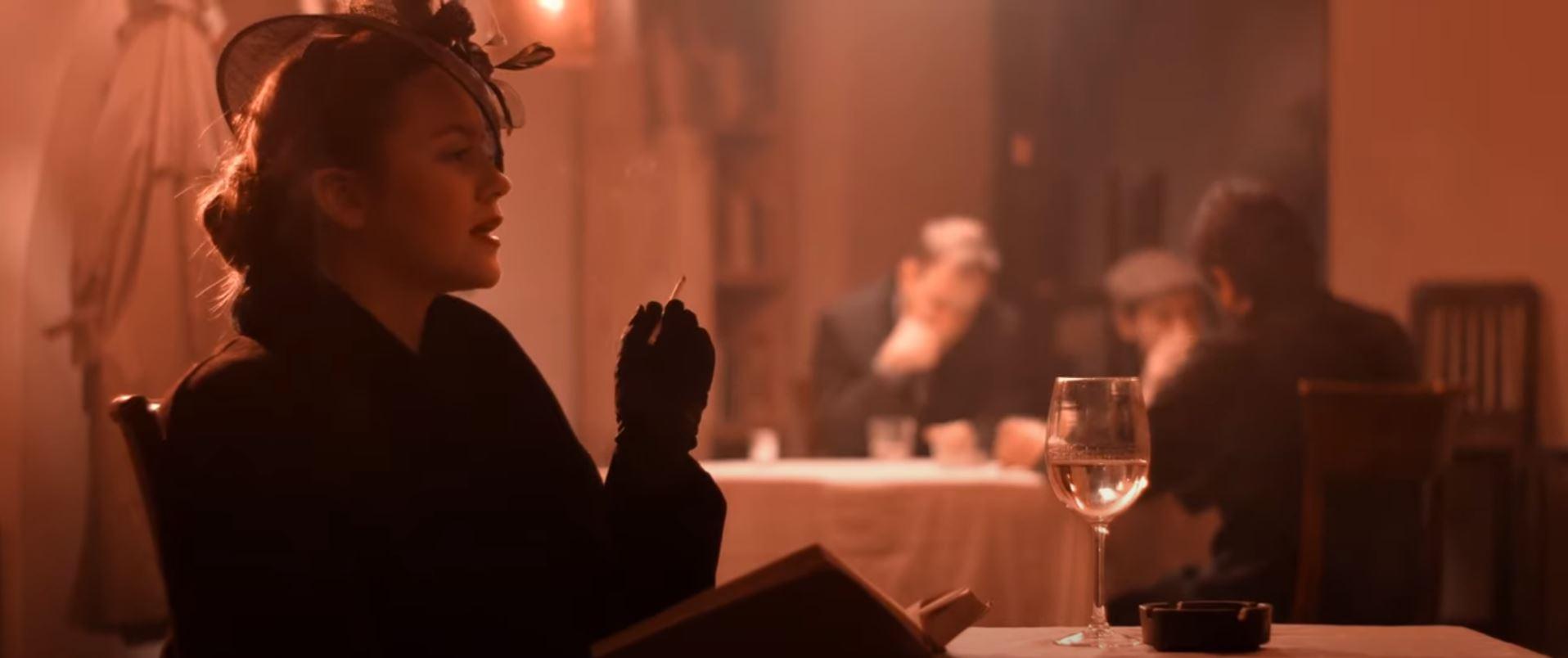 An elegant woman sitting in the bar smoking cigarette in 20s styke